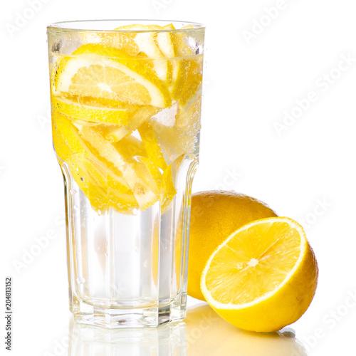 Glass lemonade lemon water with lemon