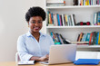 Beautiful african american businesswoman working with computer