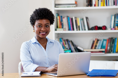 Foto Murales Beautiful african american businesswoman working with computer