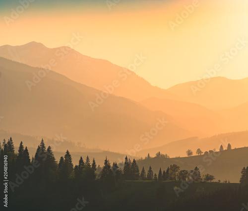 Plexiglas Lente Mountains in a beautiful light of sunset