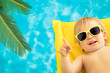 Funny baby on summer vacation