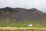 Lonely House In Wide Icelandic Landscape