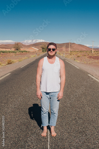 sporty guy on the road in the desert