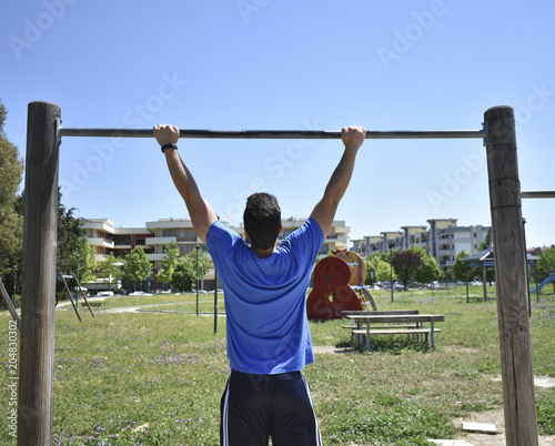 Fototapeta Young Man Doing Training Exercises