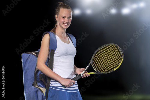 Fotobehang Tennis Portrait of beautiful girl tennis player with a racket on dark background