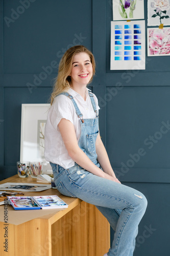 art painting hobby. creative leisure. girl sitting near a drawn picture. talent inspiration creation and self expression concept