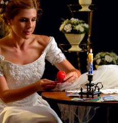 Bride thinking about choice of groom. Woman in wedding dress dreams of holiday night. Girl is preparing for ceremony. Fears of bride before wedding night. © Gennadiy Poznyakov