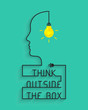 Think outside the box concept with light bulb and head silhouette. Wire forming the saying and box itself.