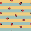 seamless striped yellow and blue background with ladybugs. Hand drawing illustration.