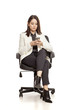 pretty businesswoman texting on her smartphone on white baclground