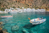 Fishing boats and the scenic village of Loutro in Crete, Greece - 204879753