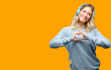 Young Beautiful Woman Listening To Music Happy Showing Love  Hands In Heart Shape Expressing Healthy And Marriage Symbol Sticker