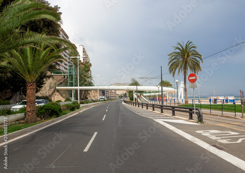 urban infrastructure on the seafront of Alicante, the tram line and a futuristic white bridge for pedestrian cycle crossings