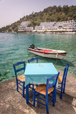 Restaurant tables by the sea in the scenic village of Loutro  in Crete, Greece - 204884360