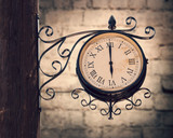 Vintage street clock on a wooden pole - 204884966