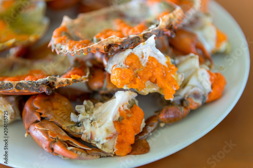 Plexiglas Thailand Boiled crab fresh and hot - delicious appetizer, steamed crab showing the delicious crab's eggs inside its shell