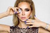 Portrait of a beautiful woman with crystals in hand. Model of make-up and manicure