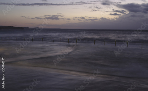 Aluminium Zee zonsondergang Stormy Morning at Collaroy Rockpool