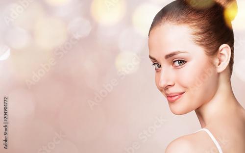 Beautiful sensual woman over beige blurry background.