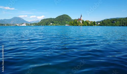 Plexiglas Blauw Lake Bled and mountains.