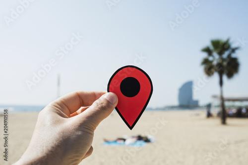 Fotobehang Barcelona man with a red marker in La Barceloneta beach