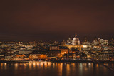 London aerial view of modern city skyline at night on River Thames