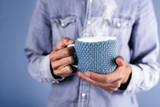 Man holding a coffee mug