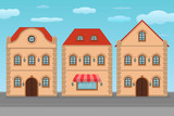 Houses. Old european city street with colored residential buildings and blue sky. Flat style