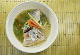 spicy boiled Tilapia fish head in Tom Yum soup on bowl