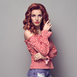 PinUp Portrait Beauty Redhead Girl.Curly hairstyle