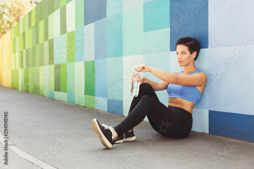 Woman choose music to listen during workout