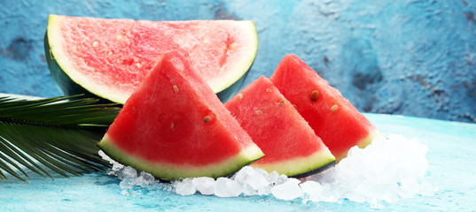 watermelon on blue background. juicy summer fruit in slices © beats_