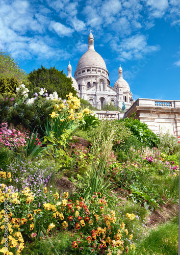 Fridge magnet Spring flowers in the garden in front of Sacre Coeur Cathedral in Paris