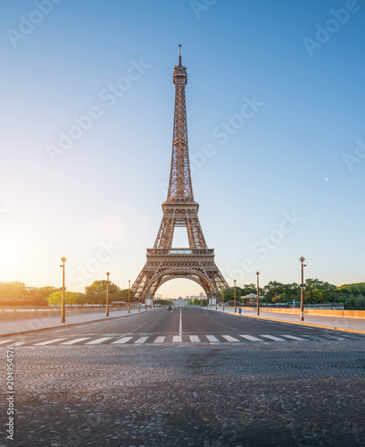 Fototapeta Paris street with view on the famous paris eiffel tower on a sunny day with some sunshine