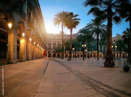 Fotobehang Barcelona Sun rises over illuminated Plaza Real in in Gothic quarter of Barcelona, Spain