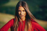 Portrait of a beautiful young woman in nature - 204976796
