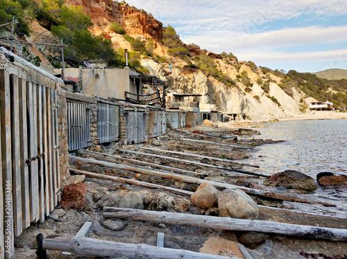 Cala d'Hort beach and boat garages. Ibiza Island. Spain