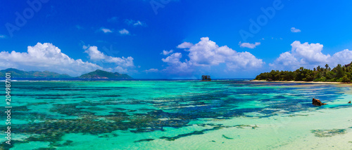 Beautiful coastline on the island of Seychelles. Blue ocean wter, white sand, empty beach. - 204987101