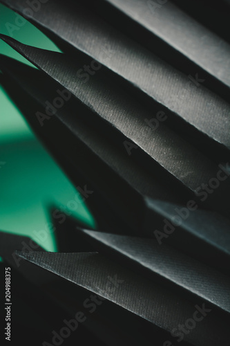 Abstract black paper structure background close up