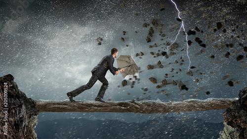 Businessman with black umbrella. Mixed media