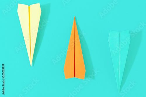 Flat lay set colorful paper plane pastel turquoise background Creative travel background © kucherav