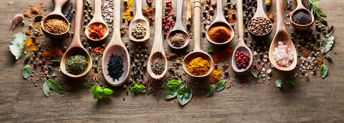 Herbs and spices on wooden board © Dionisvera
