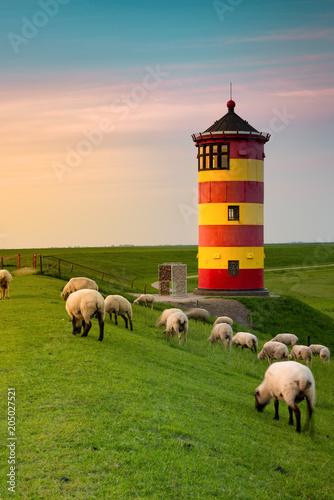 Fotobehang Vuurtoren A beautiful lighthouse on the East Frisian coast