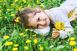 Little girl with dandelions .Funny girl on the grass