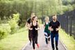 Friends jogging outdoors
