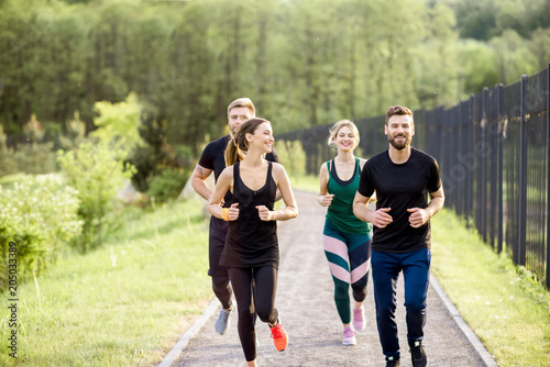 Fototapeta Friends jogging outdoors