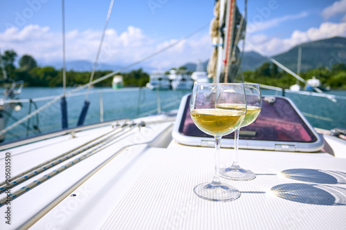 Fototapeta Pair of wineglasses against the yacht