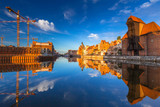 Historic port crane of Gdansk reflected in Motlawa river at sunrise, Poland - 205035920