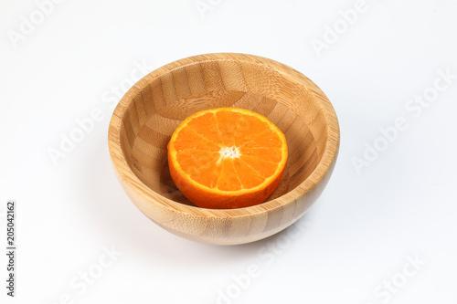 Half Sliced Orange mandarin Lemon in a bowl