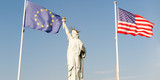 Ellis Island with statue of liberty and usa europe flag in wind - 205044985